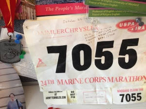 The Madwoman's finisher's medal and race bib from 1999 Marine Corps Marathon.